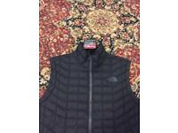 Brand new north face body warmer, large