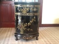 Oriental corner cabinet finished in black lacquer with gold & coloured design.