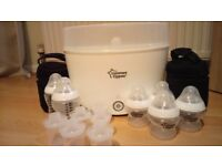 Electric Tommee tippee steriliser with bottles, bottle covers and milk dispensers