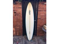 7'3 Custom Bunty surfboard.