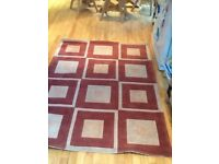 Rust and tan rug good condition