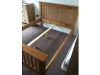 Good solid pine king size bed frame in Exeter