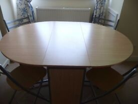Folding dining table with 4 folding chairs. REDUCED!