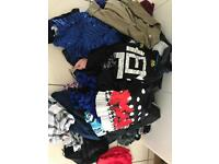 Bundle of 55 mostly new un tagged clothes