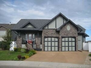 Executive home w/sunroom, self-contained guest suite, RV parking