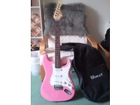 Pink electric guitar plus amp and accessories