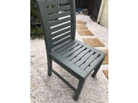 Four wooden patio chairs