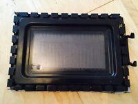 Inside glass door of Morphy Richards MM82 Standard Microwave - component