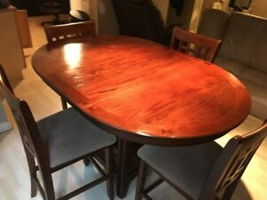 5 piece wood finish table and chairs. Like new. Barely used.