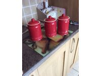 Red kitchen canisters tea coffee sugar