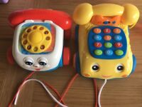 Two pull along toy phones