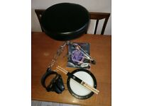 Drum stool, sticks, practice pad, tutorial book, headphones