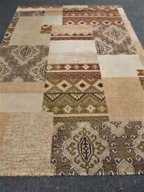 AZTEC BROWN/ BEIGE PATTERNED RUG 200CM X 290CM IN VERY GOOD CONDITION - POLYPROPYLENE - HARD WEARING