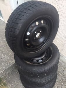 "Set of 15"" Winter tires rims Like new"
