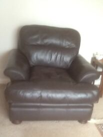 Leather sofa, chair and stool in dark brown