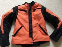 Ladies ISS Waterproof Motor bike jacket size medium.