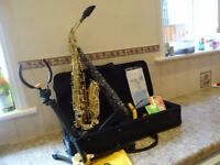 Alto Saxophone with hard case, folding stand and Accessories