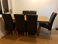 Oak vaneered soild chunky style dinning table with 6 leather effect chairs