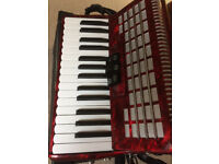Scarlatti accordion. Red, 48 bass. Great condition and in case.