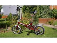 Folding bike, used, with extended seat post