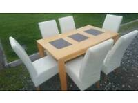 Table with six leather chairs.