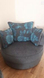 Corner sofa with swivel snuggle chair