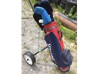 Spaulding golf clubs and bag and trolley