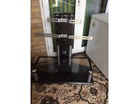 Tv stand with glass shelf in good condition