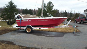 14' Grew with 70hp motor and trailer