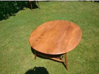 Ercol Supper / Coffee Table Model 454 with magazine rack. Refurbished top.