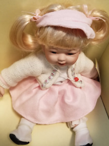 COLLECTIBLE FINE PORCELAIN BLONDE HAIR BLUE EYES (NEW)