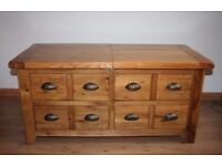 Wooden coffee table with storage drawers