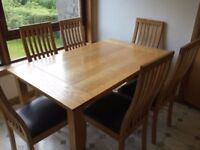 OaK Dining and 6 comfortable dark brown chairs in Good condition