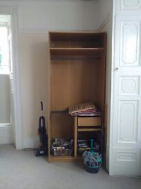 Two double wardrobes with top shelf, 4 mesh drawers and one wooden drawer each