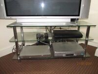 Clear glass TV stand.