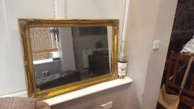 Large gilt ornate mirror.