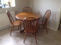 Wooden kitchen table with four chairs