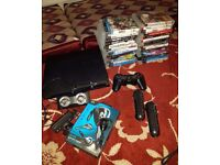 Sony PlayStation 3 Slim 320 GB Black Console with PS Move, Camera and 27 games