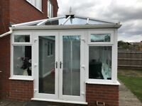 For sale a lovely white conservatory