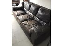 Three seater leather couch.