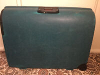 Very big green hard shell lockable suitcase with 2 wheels and handle