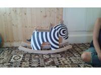 Handmade wooden rocking zebra