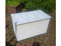 Large bedding/storage box on wheels with cloud print top