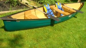 Coleman green plastic canoe, 16 ft with life jackets, & paddles