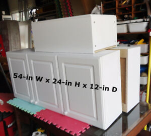 FOUR white kitchen/laundry cabinets (used)