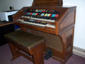Only $100. buys this beautiful Hammond organ.