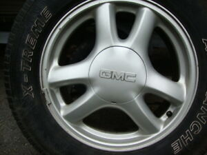 factory aluminum rims with snow tires mounted and balanced