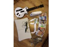 Nintendo wii plus games and guitar
