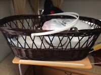 Brown wicker Moses basket- pink interior. Ideal for new born baby £30