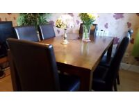 Dark Brown Wood Posh Dining Table with 6 Leather Chairs